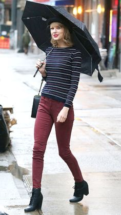 APRIL 29, 2014 Not even April showers can put a damper on Swift's style, who was all smiles in a striped long-sleeve top, burgundy skinnies, a felt hat, and black lace-ups.