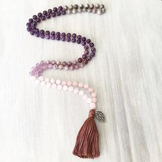 This Mala is powerfully protective, calming, balancing and full of love and self acceptance. Rose Quartz, Amethyst, Tourmaline, Agate, and Jasper all fuse together to give its wearer the strength needed to face anything with courage, love, confidence and strength. #jackalopephoenix #phx #az #jackalopeartfair