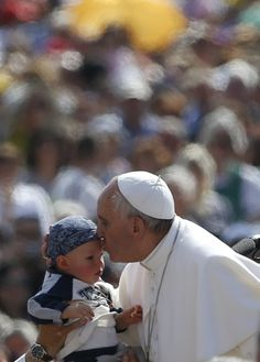 Pope Francis kisses child during weekly audience at Vatican  Pope Francis kisses a child as he arrives to lead his weekly audience in St. Peters Square at the Vatican May 8. (CNS photo/Stefano Rellandini, Reuters)