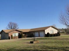Great location on the edge of Ava, Mo in an upscale country sub-division. Level 1.6 Acres landscaped & outline in trees. Drive your golf cart to the golf coarse while you live in the magnificent 2600 sq ft (brick and stucco) rancher. The home features 3 bedrooms, 2.5 bath, unbelievable kitchen, central heat and air, covered porch that has the view of the year! There is also a 2 car attached garage. The kitchen has mega cabinets, all appliances, 2 pantries, hardwood flooring, breakfast area