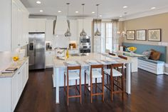 Miller & Smith is an experienced home builder in MD, VA. Miller & Smith offers new home construction and new homes for sale. Light Granite Countertops, White Stove, Eat In Kitchen, Kitchen Decor, Built In Bench, Floor Colors, Hardwood Floors, Dark Hardwood, Flooring