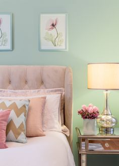Artwork of pink poppies is accentuated by the pink pillows and tulips