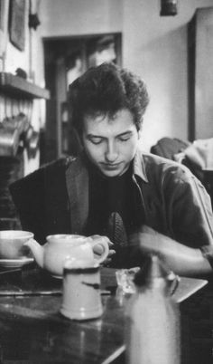 Tea and a kitten. New York coffee house 1963. Photograph by Jim Marshall.