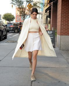 Kendall dresses down her all-white ensemble with a pair of sneakers. This sporty-chic look is perfect for her trip to the US Open!    - Seventeen.com