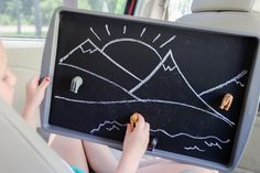 Attach chalkboard paper to an old baking tray for a portable, magnetic play station.