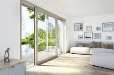 Sliding doors have large panes of glass that bring plenty of natural light into any room. Wood/aluminum sliding door HS 330. Photo credit: Internorm. #schiebetüre