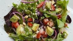 Beets add a nice sweetness and color to this salad made with spinach, feta cheese, and avocado that is tossed in a light lemon dressing.