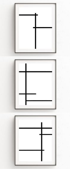 Oju Design has created this collection of 3 minimalist art prints that use bold black lines to break up the all white background.