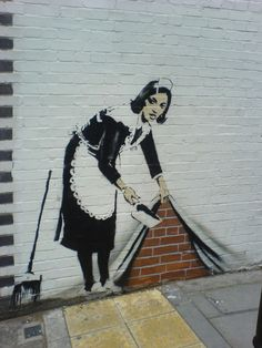 #5. In this piece by Banksy, a maid appears to be either sweeping something under the rug, or pulling up a curtain to reveal some sort of secret behind it. I personally believe Banksy might have been addressing how the government may keep things from the public, and this person is uncovering it. I believe the purpose of Banksy's work is to get people to open their eyes and really think about specific issues.