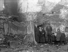 """Three generations of a family pose beside their """"home"""" at Alexander Street, Waterford, 2 February A. National Library of Ireland. Old Photos, Vintage Photos, Vintage Photographs, Irish Wolfhound, Family Posing, Historical Photos, 19th Century, Past, History"""