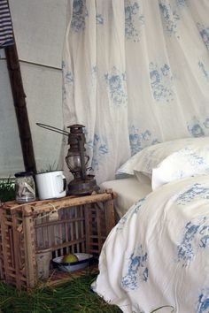 love this blue and white faded floral bedding and curtain fabric by cabbages and roses - summer camping in style with canopy and real bed linen. Click through for more floral bedroom and living room ideas you'll love #floralbedroom #cabbagesandroses #frombritainwithlove #blueandwhite #countryhome #bedroomideas