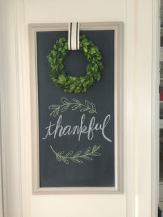 Autumn Thanksgiving chalkboard with boxwood wreath