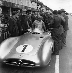 Juan Manuel Fangio getting out of his Mercedes | Formula 1 photos | ESPN F1 1954