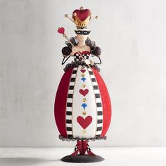 The Queen of Hearts has expanded her empire and claimed your home as part of her realm. Whether she's the center of attention atop your table or stands tall on your mantel or accent table, she reigns supreme.