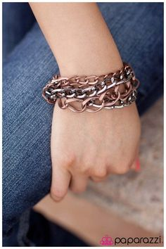 Material Girl: Large twisted copper links , two strands of medium gunmetal chain and two strands of small copper chain lay side by side. Buy now from www.paparazziaccessories.com!