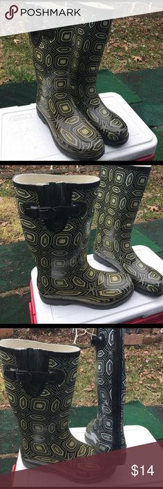 Rain boots Size 9 Rain boots size  9   Color grey white one side gold grey  white on other side not new good condition height 13 inches from floor not sure Shoes Winter & Rain Boots