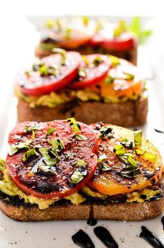 Avocado + Heirloom Tomato Toast With Balsamic Drizzle. I added a little garlic salt to the bread and I thought it was absolutely delicious! Avocado + Heirloom Tomato Toast With Balsamic Drizzl Think Food, I Love Food, Good Food, Yummy Food, Tasty, Aperitivos Vegan, Whole Food Recipes, Cooking Recipes, Cooking Games