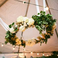 Hanging floral white and green wreath // Sasithon Photography // http://www.theknot.com/weddings/album/a-rustic-fall-wedding-in-brooklyn-ny-128912
