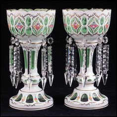 PAIR OF BOHEMIAN CASED GLASS CUT-TO-GREEN LUSTRES, HAND PAINTED FLORAL DECORATION WITH GILT ACCENTS, BEARING EIGHT PRISMS EACH