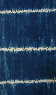 "Indigo shibori panel, Japan, Taisho (c.1920), 151x33cm. The common English translation of the Japanese word shibori is ""tie-dye""; however, a more accurate translation is ""shaped-resist dyeing,"" which describes the inherent patterning process  ..."