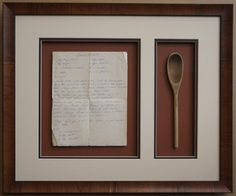 """This photo comes to us from Tangled Tree Framing. It features our Tabacchino moulding housing a recipe for """"Grandma Donuts"""" with her favorite wooden spoon."""