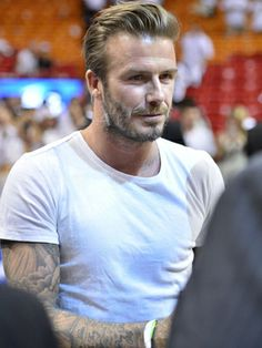 David Beckham sits court side at the Miami Heat vs. Brooklyn Nets NBA Playoff basketball game in Miami.