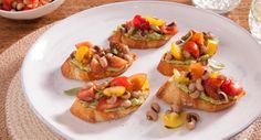 Peckish? Phoodie shows us how to get through the day with this Heirloom Tomato & Avocado Bruschetta featuring our NEW Black Eye Beans.  #vegetarian #italian #recipe