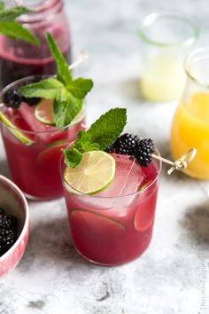 This tiki inspired blackberry pineapple rum cocktail is made with lime juice, dark rum, pineapple juice, and blackberry syrup. It's a lively and refreshing summer beverage!