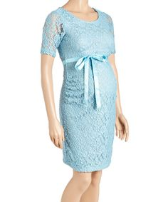Delicate lace imbues this comfy maternity dress with grace, and a side cinch and satin belt ensure a flattering fit.