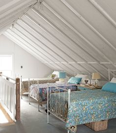 Old iron-beds in a barnhouse attic, courtesy of House Beautiful