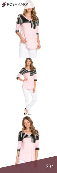 Striped Quarter Sleeve Top Striped pocket detail and upper body ¾ sleeve length top. Details include pink color block body, with striped upper and sleeve ends, with a striped front pocket. Material content is 96% Rayon, and 4% spandex to give a slight body stretch to the fabric. These pieces are made in the USA. 100% USA based manufacturing and size scale. True to size. The striped are black and white small stripes. Tops