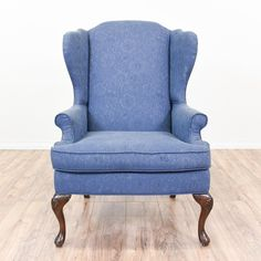 This wingback armchair is upholstered in a durable blue fabric with floral print details. This chair is in great condition with a tall wing back, curved cabriole legs and a solid dark cherry wood finish. Comfortable and classic chair perfect for a sitting room! #victorian #chairs #armchair #sandiegovintage #vintagefurniture