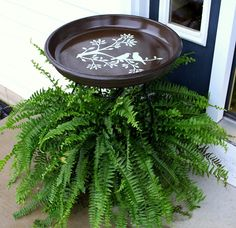 diy bird bath with a plant saucer and a plant stand liquid nailed together