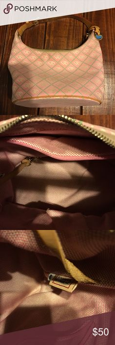 PRICE DROP! Dooney & Bourke bucket purse Very good condition Dooney and Bourke purse! Pretty light pink with light green lettering. I just wiped it down with a rag and mild soap, but may need to be washed again to brighten it up a little. I don't know how to properly clean this brand so I didn't want to do too much! This is a great steal!  As always, I am open to offers on any of my listings! Width- 6.5 inches. Length- 11 inches. Strap to bottom- 13 inches. Dooney & Bourke Bags Shoulder Bags