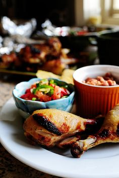 Pollo Asado - great flavor.  The longer it marinades, the better. (serve with rice, beans and homemade salsa/guacamole!)