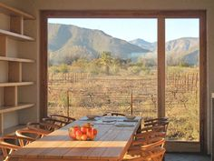Dining Room with a view of a vineyard and the Swartberg mountains in South Africa. The Architect Is In: A Passive Solar House for a Family of Stargazers - Remodelista Passive Solar Homes, African House, Desert Homes, Solar House, Decoration Inspiration, Architect Design, Large Windows, Beautiful Buildings, Planer