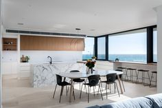 Coastal kitchen vibes in this kitchen design by Urbane Projects featuring picturesque views of the ocean. Stone Flooring, Kitchen Design, Coastal, Ocean, Interior, Table, Projects, Room, Furniture