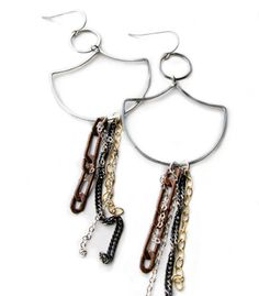 Minoux swinging gingko earrings    We're mixing our metals. Copper, silver, gunmetal and gold chains,  earrings swinging from ear to shoulder. $98