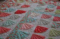 Ruby Fans fmq'd by Karee at FabricFulfillingItsDestiny  (pieced by Joan, just her 2nd quilt top... that's right her 2nd!)