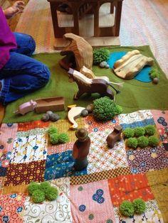 Homemade farm play mat in use.