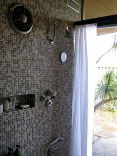 Original shower and fixtures; liking the wall of windows.