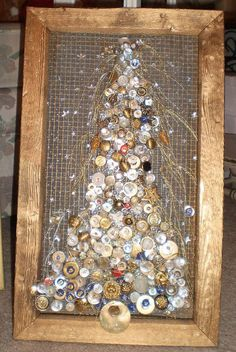SALE PENDING ....One of a kind handmade Christmas tree, size 11 by 18. It is in a antique weathered wood frame painted lightly with gold. Vintage buttons