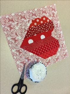 Would you like to make a fun, strippy, scrappy heart block for Valentine's Day? Here's a simple 8 1/2'' block that will sew up in a snap!