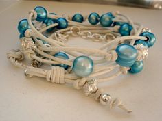 Leather Wrap Bracelet, Aqua Pearls with White Leather & Sterling Silver, White Cuff Wrap. $115.00, via Etsy. 22 inches long, can be worn as necklace