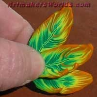 Orange Edge Green Feather polymer clay cane