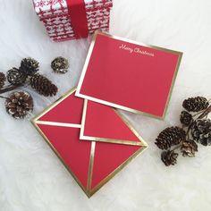 Wish a Merry Christmas with a heartfelt handwritten card. - Flat red card with gold foil border - Includes red envelope with gold foil border - Includes ink test paper swatch - Letterpress printed wit