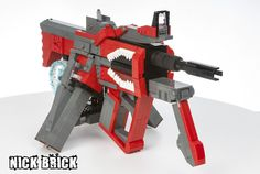 """The Bandit gun philosophy is simple: MORE BULLETS! MORE SHOOT BITS FOR BRAIN SPLATS! BANG BANG BANG BANG! ...BANG!  Bandit SMGs are made with components of other Borderlands gun manufacturer's SMGs. This one (the """"bulets go fasterifed rokgun"""") is made with a Bandit body, Dahl barrel, Tediore stock, and Hyperion grips and sight.  Working features: moving trigger, removable dual magazines, and working reflex sight with a yellow dot reticle.  This build was commissioned by Simon Liu."""
