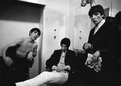 Keith Moon and Pete Townshend with a fan backstage at the Jigsaw Club