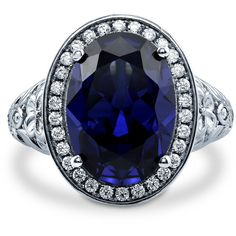 Silver Oval Simulated Sapphire CZ Halo Art Deco Right Hand Cocktail... (£55) ❤ liked on Polyvore featuring jewelry, rings, sapphire, sterling silver, women's accessories, silver rings, silver sapphire ring, sapphire band ring, art deco sapphire ring and cubic zirconia rings