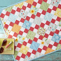 Bright print squares alternate with Four-Patch blocks in a cheerful table  runner.Fabricsare from the Oh Clementine collection by Allison Harris for  Windham Fabrics [1].   [1] http://windhamfabrics.net